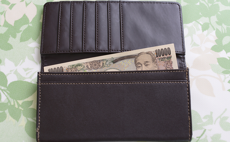 Wallet containing a yen banknote