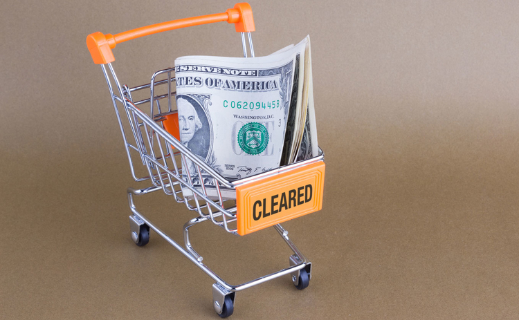 Photo of trolley with dollars