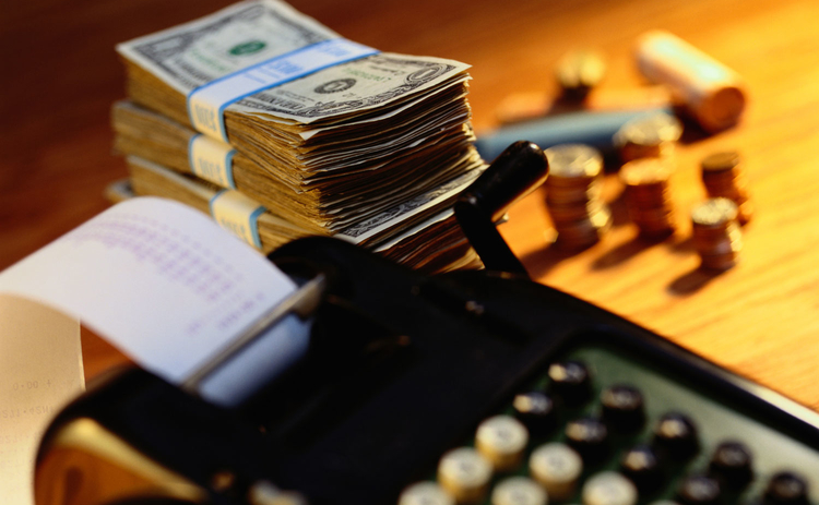Image of dollar and calculator