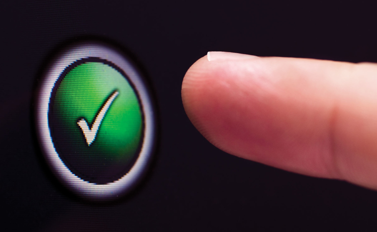 Finger on approval button