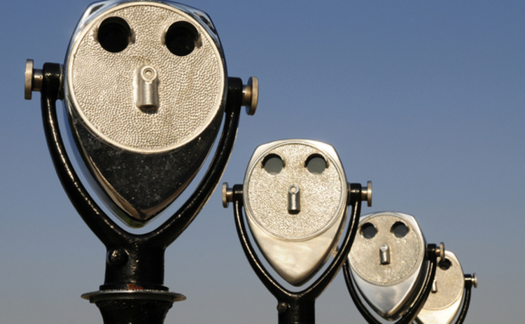 receding-row-of-four-long-range-binoculars-perspective-faces