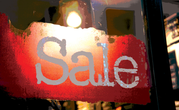 Sale sign in window