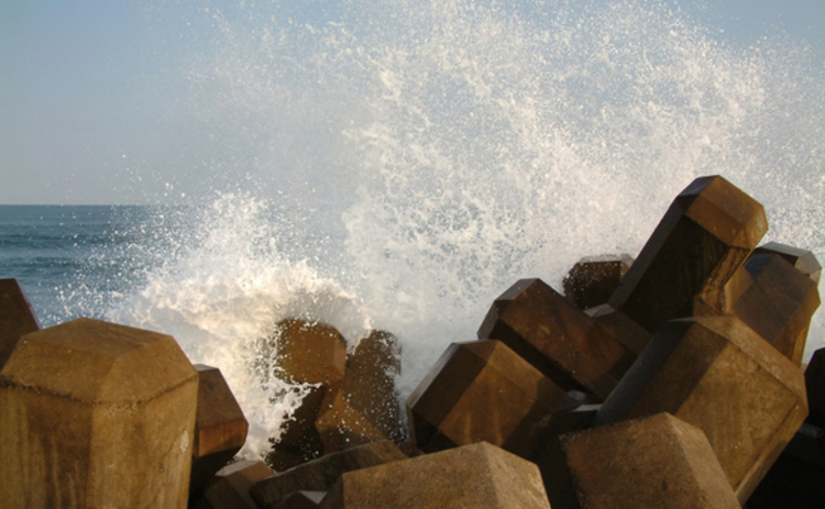 wave-crashing-against-breakwater
