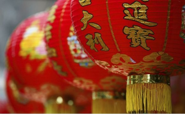 row-of-three-red-and-gold-chinese-lanterns