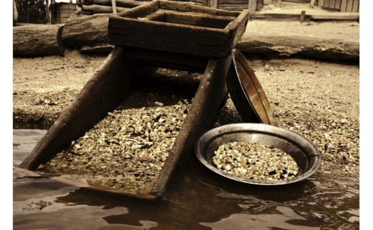 sepia-gold-panning-apparatus-by-stream
