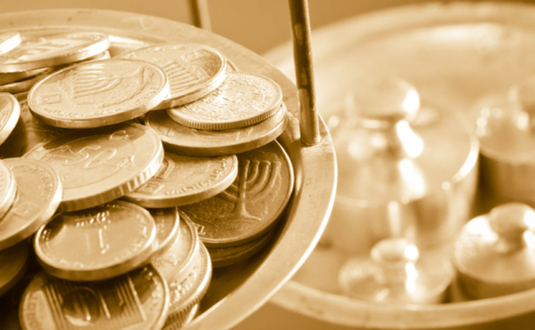 image of coins being weighed