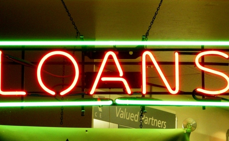 A neon sign advertising loans