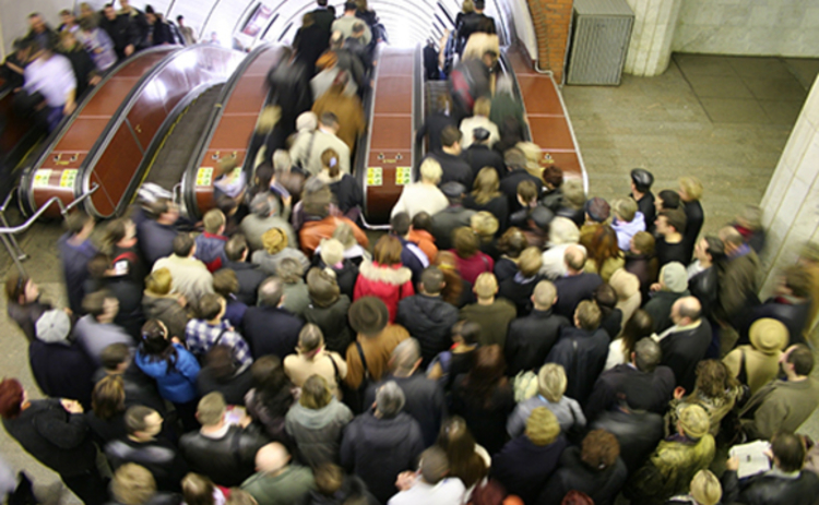 Photo of a crowded escalator in the London Underground