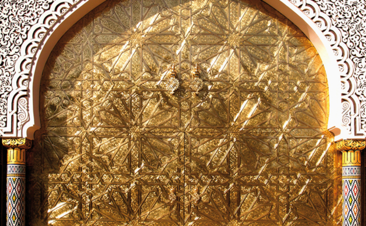 gold-islamic-door-with-white-details-and-pillars