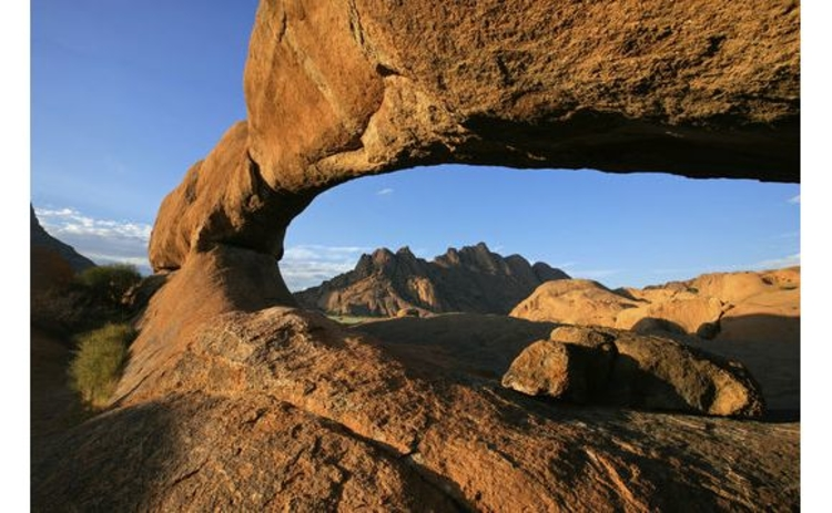 namibia-red-natural-granite-arch-in-desert-against-blue-sky