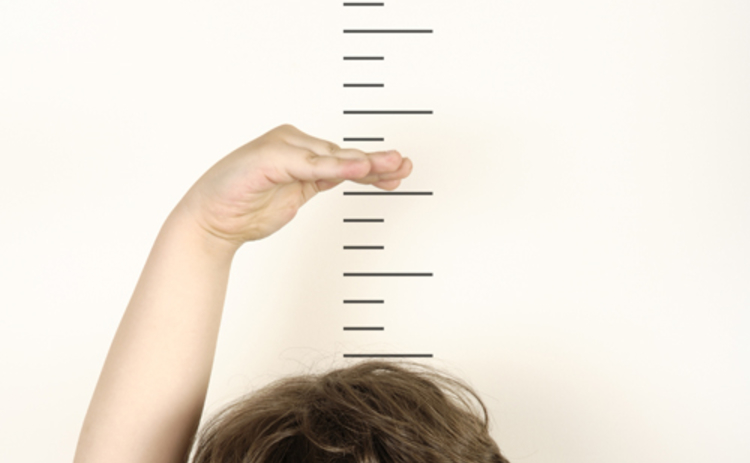 boy-measuring-height