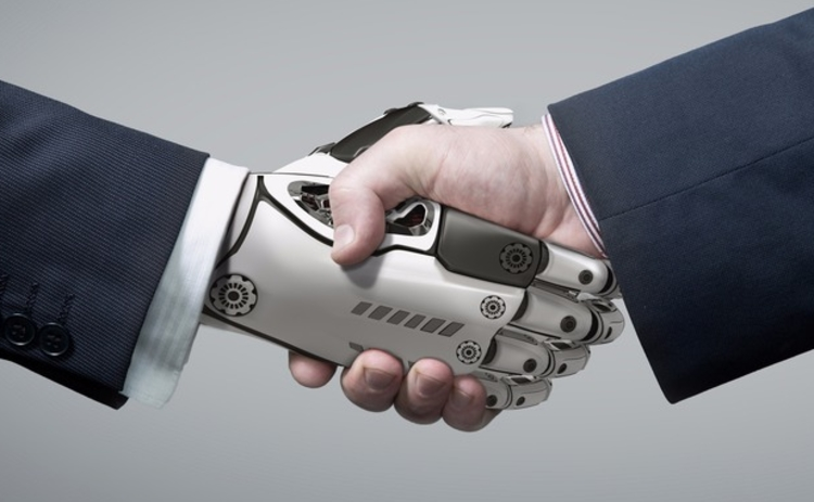 Human shaking hands with a robot