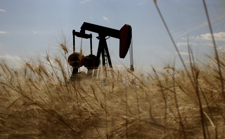 oil-rig-silhouetted-in-wheat-field