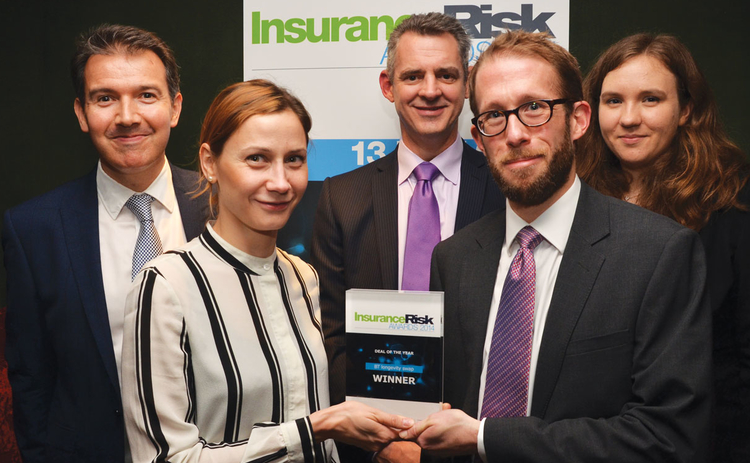 BT staff show off their Insurance Risk award for deal of the year