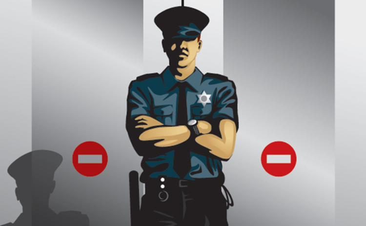 Policeman in front of no entry sign